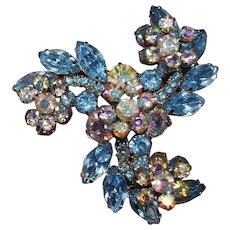 Juliana Brooch Blue Rhinestones Swirl with Raised Clear Aurora Borealis Flowers