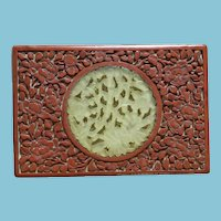 ca 1900 - 1925 Red Cinnabar Box with Hand-carved Serpentine Stone Relief Pierced Medallion
