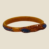 Celluloid snake two heads;  Egyptian revival extensible bracelet w/ rhinestones