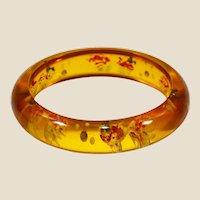 Great genuine bakelite (tested) bangle bracelet goldfish design carved