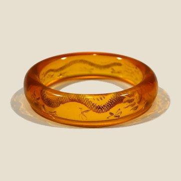 Mid century 50's reverse carved dragons Lucite bangle bracelet