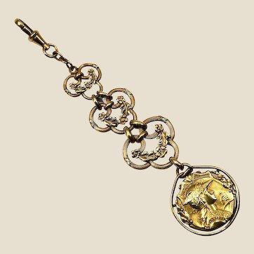 French ORIA 18K gold rolled chatelaine with a F. Lasserre medal