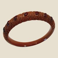 Unique tested bakelite,bangle bracelet, hand carved with red stones