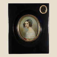 American School Ca. 1830 miniature young Lady with locket. Possible mourning piece.