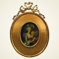 Miniature portrait of a Lady on celluloid signed. Brass & silk frame