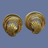 Elegant Gold Tone Swirl Clip On Earrings