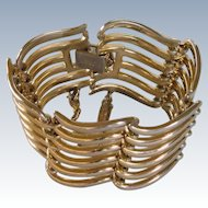 Monet Gold Tone Cuff Bracelet with Chain Guard