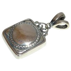 Silver Tone Pendant with Black Accents