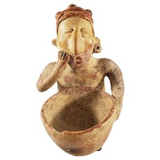 Pre-Colombian Pottery Figure holding a Small Bowl