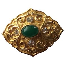 Elegant Brooch with Green Stone accented by clear rhinestones.
