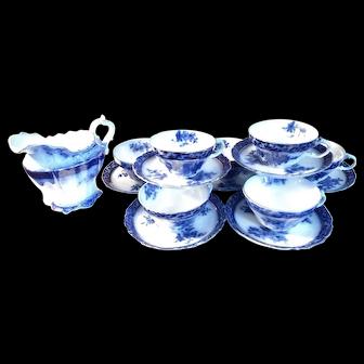Antique Henry Alcock Flow Blue Creamer with 7 Teacups & Saucers Set