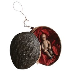 Antique Christmas ornament nut with all bisque doll