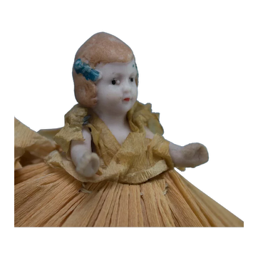 "3"" Antique All Bisque Doll in Original Crepe Paper Dress"