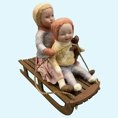 Wonderful Artist Bisque Head Children on Sled