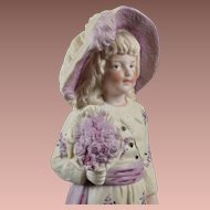 Delightful Heubach Figurine Boy with Flowers - 9.5 Inches