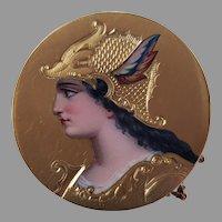A 19th century circular 14k gold and enamel brooch depicting Athena, 2.8cm diameter