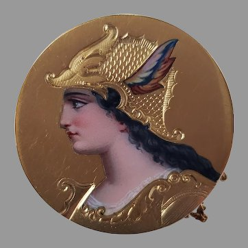 A 19th century circular 14k gold and enamel brooch depicting Athena, 2.8cm diameter