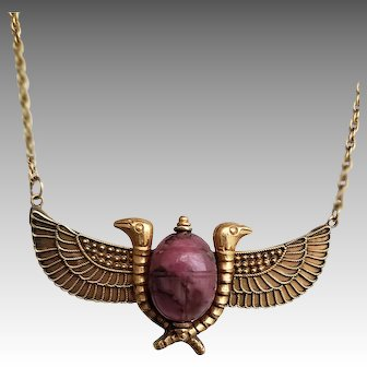 A late Victorian Egyptian Revival Scarab beetle pendant with Ancient carved Rhodonite and winged serpents