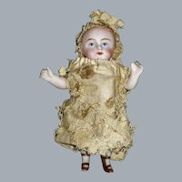 """3 1/2"""" Early All Bisque Wrestler Doll"""