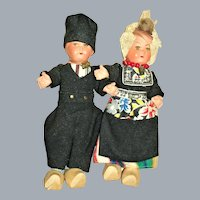 """7"""" and 6 1/2"""" Painted Bisque and Cloth Dutch Couple NRFB"""