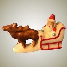 Antique German porcelain miniature Santa in sleigh snow baby