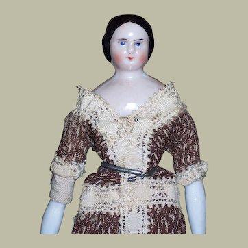 A Precious Dollhouse China Head Doll