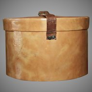 A Wonderful Antique Hatbox with Leather Strap Closure