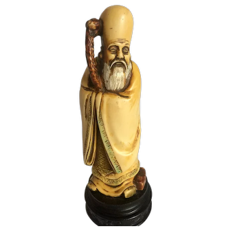 Chinese wiseman resin figure on wood base, mid 20th Century