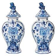 Delft Dutch Faience Floral Lidded Vases, a Pair