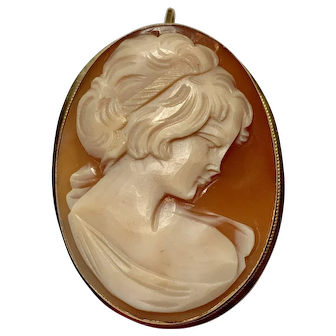 Cameo pin of beautiful young woman in 18k yellow gold bezel.