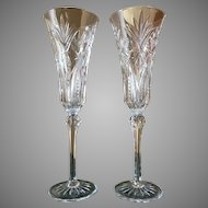 Pair cut crystal champagne toasting fluted glasses