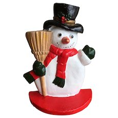 Cast iron snowman door stop, bookend with Holly berry hat