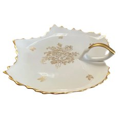Royal Limoges leaf shape dish, white with gold trim and flowers, with handle.