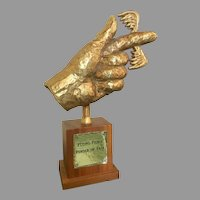 Flying Fickle Finger Of Fate bronze award from ROWAN & MARTIN'S laugh-in show