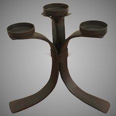 Wrought iron four tealight votive candelabra