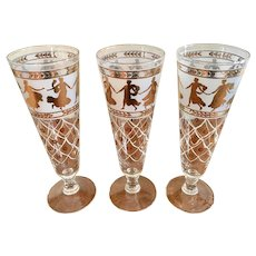 Set of three tall footed drinking barware glasses