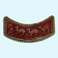 Asian Cinnabar Brooch with Marco Polo and Three Camels