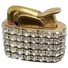 Lady's  rhinestone covered cigarette lighter