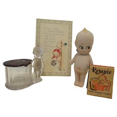 Collection of Antique and Vintage Kewpie with Christmas Postcard and Candy Container