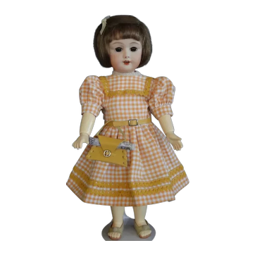 """Bleuette SFBJ 301 reproduction - 11"""" doll with brown eyes."""
