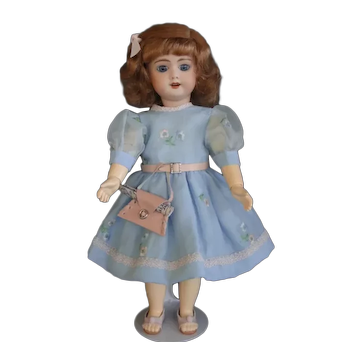 """Bleuette SFBJ 60 reproduction - 11"""" doll with blue eyes."""