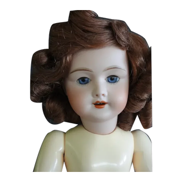 """Rosette Unis 301 reproduction - 14"""" doll with blue eyes."""