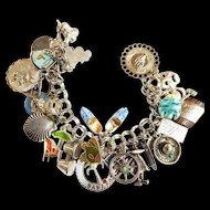 Vintage 24 charm heavy silver bracelet great charms