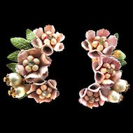 High end vintage pastel pink tiered flowers with tiny cream colored beads in the centers.intage Pretty in Pink Earrings