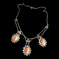 Early 1900s festoon coral colored cabochon glass necklace.