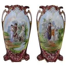 A Pair Of  Czech Carlsbad Porcelain Vases by Victoria Manufactory  Hand Painted Height 33,5cm.  Circa 1920