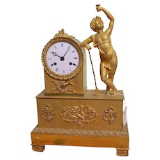 A French Empire  Gilt Bronze Mantel Clock, With The figure Of The Bacchus  1840