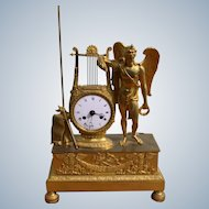 A Figural French Empire Mantel Clock In Gilded Bronze Representing The Archangel Uriel Circa 1830
