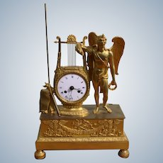 A Figural French Empire Mantel Clock In Gilded Bronze Representing The Archangel Uriel Circa 1830