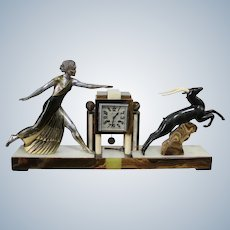Impressive  Art Deco Figural Clock  On A Marble Base The Sculpture Signed Campbell  And The Clock by Comyn Lenght 74Cm